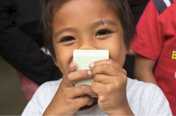 Happy child with soap - Clean the World Asia