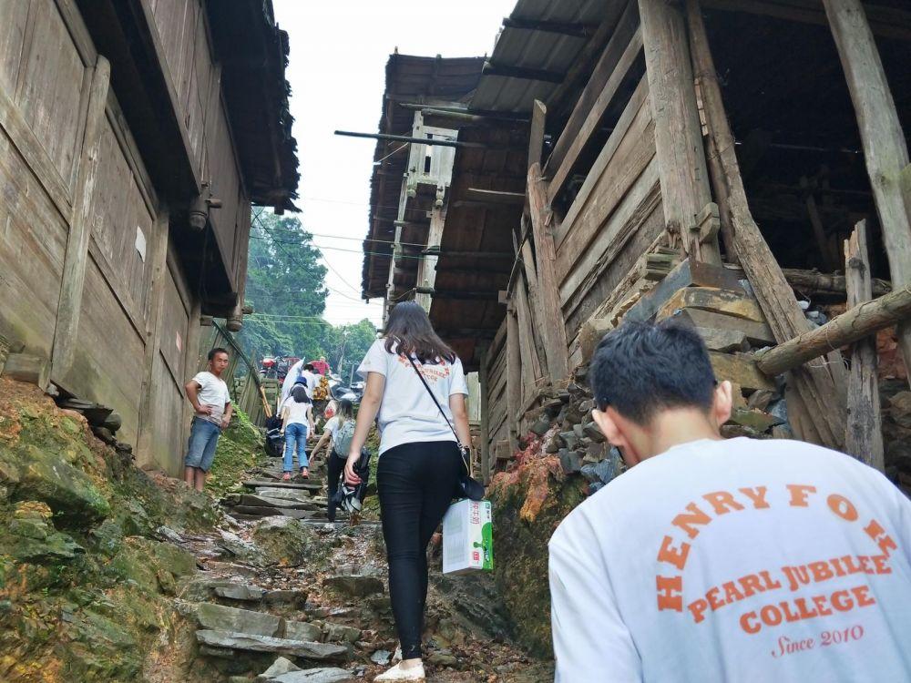 Distributing supplies - volunteers in Guizhou China